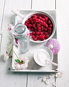 Raspberries and sugar on a tray