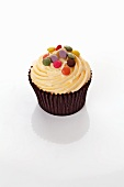 Cupcake with coloured chocolate beans
