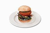 Goat's cheese burger with grilled courgette, aubergines and pesto