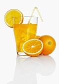 Orangeade and fresh oranges