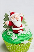 A cupcake decorated with a Father Christmas figure