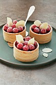 Raspberry layer cakes with marzipan leaves