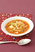 Savoy cabbage soup with potatoes, red lentils and tomatoes