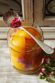 Preserved peaches with rose petals