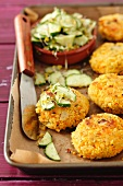 Couscous cakes with a cucumber and bean sprout salad