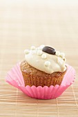 Cupcake with cream topping