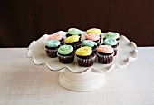 Mini Chocolate Cupcakes with Pastel Frosting on a Pedestal Dish