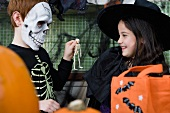 Little boy and girl at a Halloween party