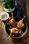 Roast wild duck legs with a vegetable sauce