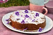 Cardamom cake with pears and violets (Sweden)