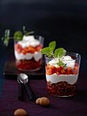 Desserts made with yogurt cream, pomegranate and papaya