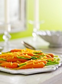 Baby Carrots with Stems and Lemon Zest on a Platter