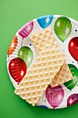 Marshmallow wafers on a colourful plate