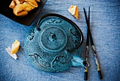 Blue Asian Tea Pot with Chopsticks and Fortune Cookies