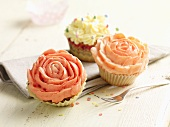 Cupcakes decorated with cream roses