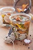 Various preserved mushrooms in a jar