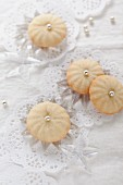 Lemon biscuits decorated with sugar pearls