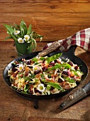 Sennerpfanne (pasta dish with ham, beetroot, vegetables and fried onions) with ramsons
