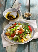 Bread salad with rocket, tomatoes and mozzarella