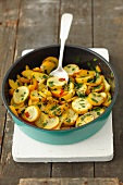 Fried yellow courgettes with garlic, chilli and parsley