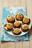 Pumpernickel canapes topped with crayfish paste