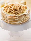 Layered honey cake on a cake stand