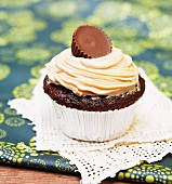Chocolate Cupcake with Peanut Butter Frosting and a Chocolate Covered Peanut Butter Candy