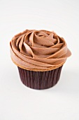 A rose cupcake topped with coffee cream