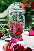Fresh strawberries in a tall jar
