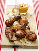 Tandoori chicken drumsticks with mango salsa