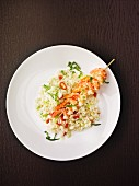 Risotto with a skewer of prawns