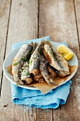 Fried herring with salt and lemon