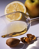 White wine, almonds, an apple and half a lemon