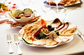 A plate of mixed starters with prawns, langoustines, and carpaccio of tuna and of swordfish