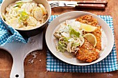 Schnitzel with an almond crumb coating and potato salad