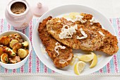 Wiener schnitzel (breaded veal escalope from Vienna) with horseradish and roast potatoes