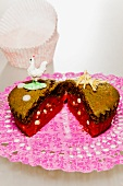 A large muffin decorated with an ornamental chicken and sugar eggs