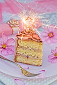 A piece of birthday cake with a sparkler