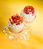 An ice cream sundae with vanilla ice cream, whipped cream and strawberries