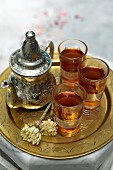 Tea in a silver teapot and glasses (Tunisia)