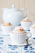Muffins baked in silicon teacups on a Dutch tablecloth