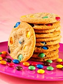 A stack of cookies with colourful chocolate beans
