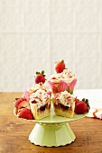 Strawberry Shortcake Cupcakes on a Pedestal Dish; One Halved
