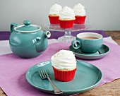Cupcakes topped with icing, and a coffee set