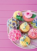 Flower cupcakes on a cake plate
