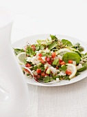 A salad of fish, avocado, pepper and lemon