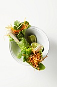 Grated carrot wrapped in lettuce leaves