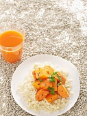 Couscous with carrots and pumpkin, and a glass of carrot and orange juice