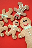 Gingerbread men on a red surface