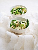 Pasta with asparagus, peas, pine nuts and brousse cheese